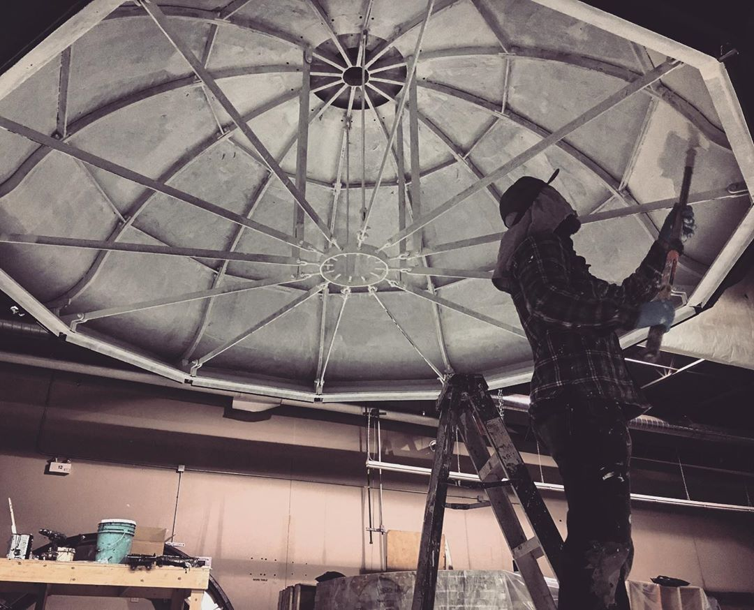 instagram: @mike_a_lewis painting the underside of the lantern house roof before it made the trip to Yarmouth to be installed. Adding all of the arms, turnbuckles and framing on the underside made it look so legit. #setdesign #setdesigner #artdirection #scenicpainting #setbuilding #setconstruction #tiff #thelighthouse #nsfilmjobs