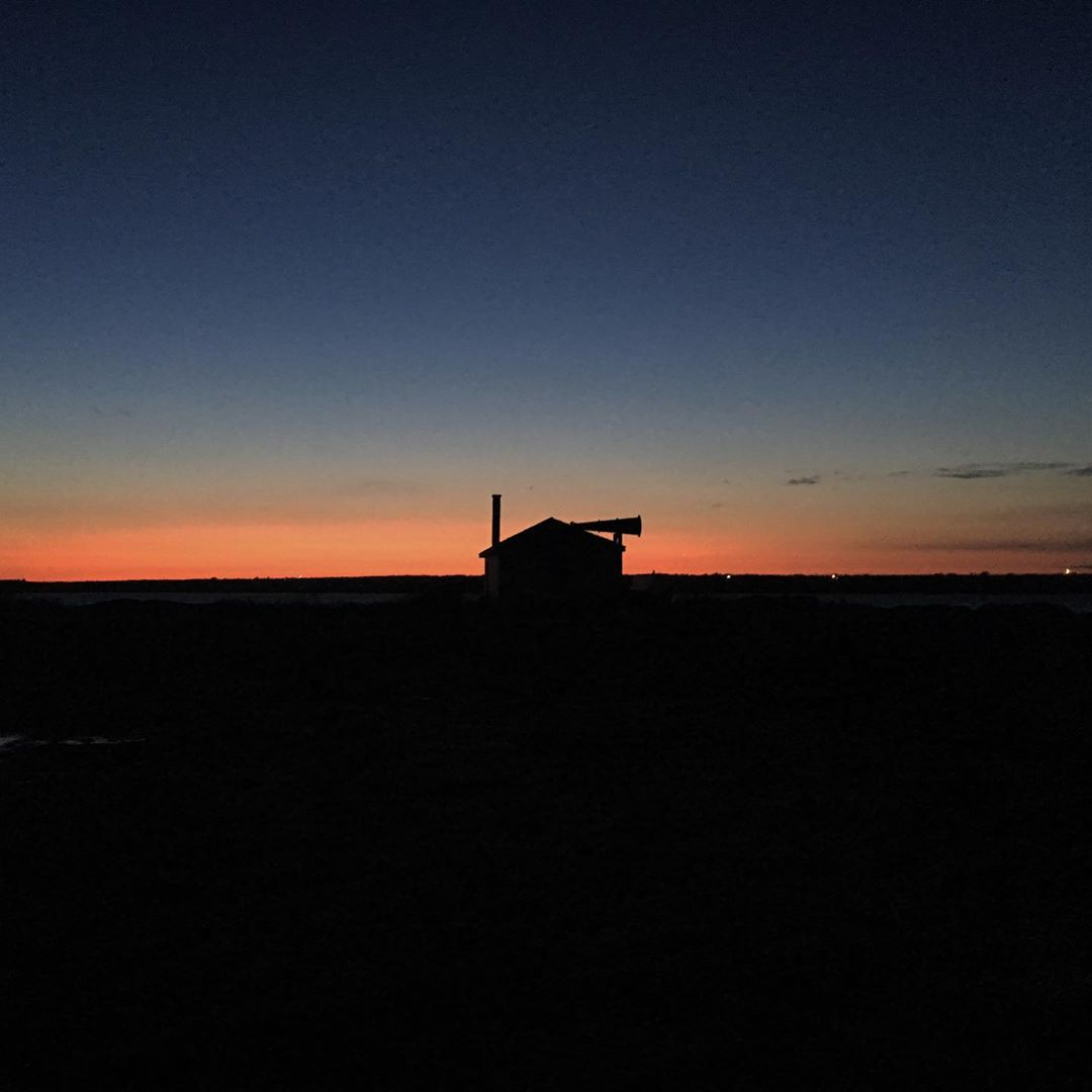instagram: One of our exterior builds on Cape Forchu for THE LIGHTHOUSE. I took this snap as the sun came up on our first morning of shooting. I think a lot of people think we filmed in Nova Scotia to use an existing lighthouse or other preexisting buildings but we actually built every structure in the film, both interiors and exteriors. #artdirection #setdesign #setconstruction #tiff #thelighthouse #nsfilmjobs